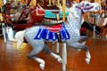 Gray horses with red & blue saddle on Merry-Go-Round Museum's working carousel. Sandusky, OH