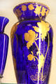 Blue glass vase with gold flowers at National Museum of Cambridge Glass. Cambridge, OH.