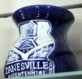 Zanesville Bicentennial ceramic jar with Y bridge & Old Capitol motif at Stone Academy Museum. Zanesville, OH.