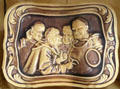 Embossed tray with monks by American Encaustic Tiling Co. at Mathews House Museum. Zanesville, OH.