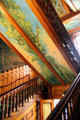 Grand staircase in Eastlake style with mural by Richard Morris Hunt at Chateau-sur-Mer. Newport, RI