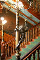 Grand staircase with torchere at Chateau-sur-Mer. Newport, RI.