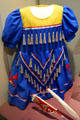 Girl's jingle dress at South Dakota State Historical Society Museum. Pierre, SD.