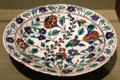 Earthenware dish with floral design from Iznik, Turkey at San Antonio Museum of Art. San Antonio, TX.