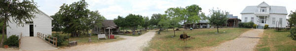 Panorama of Gonzales Pioneer Village Living History Center, a collection of 1800s structures. Gonzales, TX.