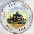 Commemorative plate depicting Comal County Court House in New Braunfels, TX at Conservation Plaza. New Braunfels, TX.