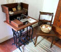 Treadle sewing machine in Baetge House at Conservation Plaza. New Braunfels, TX.