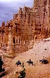Horse riders pass hoodoos in Bryce Canyon National Park. UT.