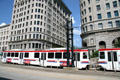 UTA Trax streetcars run in front of Boston & Newhouse Buildings. Salt Lake City, UT.
