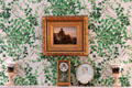 Painting, clock & green wallpaper over mantle of southeast bedroom at Marsh-Billings-Rockefeller Mansion. Woodstock, VT.