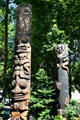 Totem poles by Duane Pasco in Occidental Park of Pioneer Square historic district. Seattle, WA.