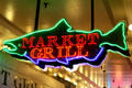 Neon fish sign in Pike Place Market. Seattle, WA.