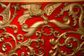 Flying eagle carving detail on red & gold lion tamer circus wagon at Circus World Museum. Baraboo, WI.