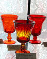 Jamestown water goblets in red & amberina at Fostoria Glass Museum. Moundsville, WV.