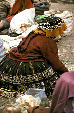 Native dress in Pisac market. Peru.